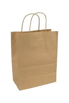 白い背景の上の紙袋。パッケージ分離。使い捨ての紙袋。ハンドル付きの紙袋。