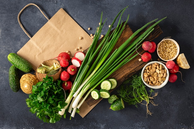 Paper bag with different vegan healthy food top view