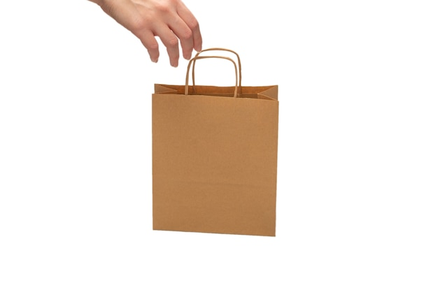 Paper bag in woman hands isolated