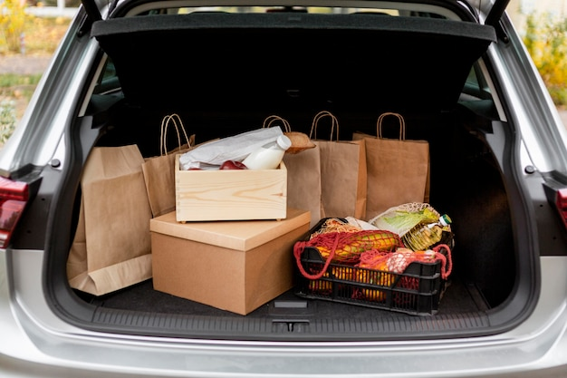 Paper bags and crates in car's trunk