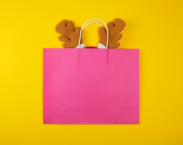 Paper bags for shopping with deer headband inside