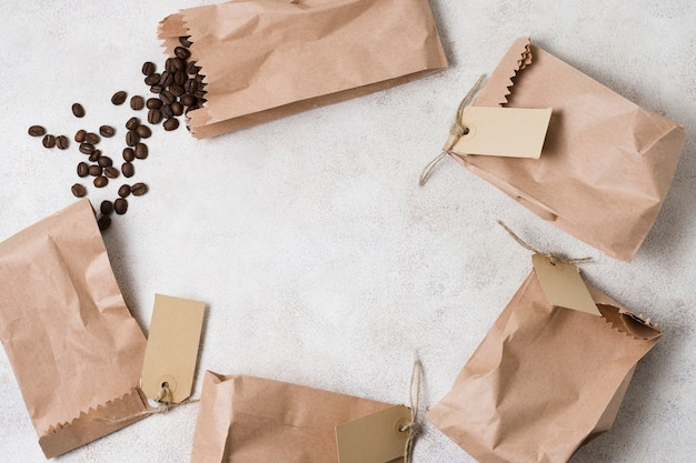 Paper bags with labels filled with coffee beans and copy space