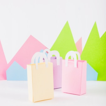 Paper bags with paper mountains on table