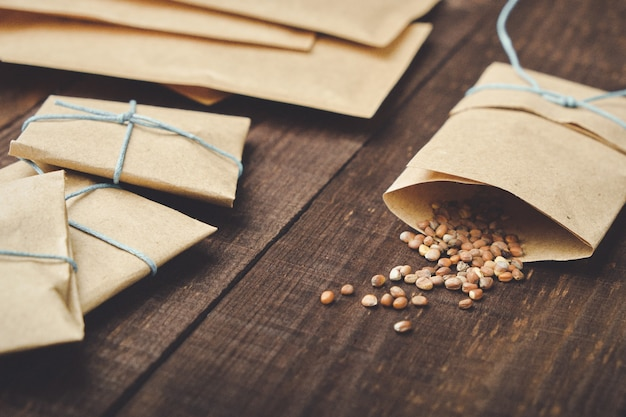 Paper bags with seeds for planting. sprinkled radish seeds.