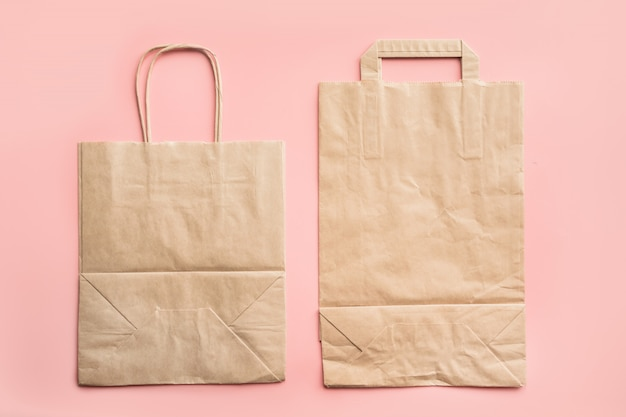 Paper bags for zero waste shopping on pink.