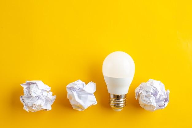 Paper balls and lightbulb