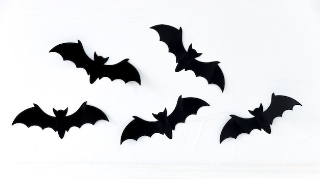 Paper bats hanging on wall
