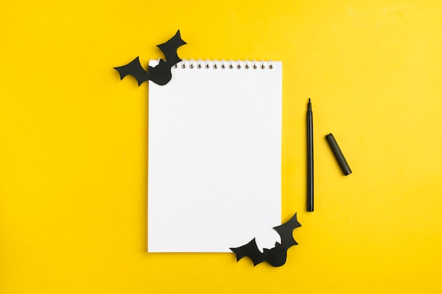 Paper bats and a notebook