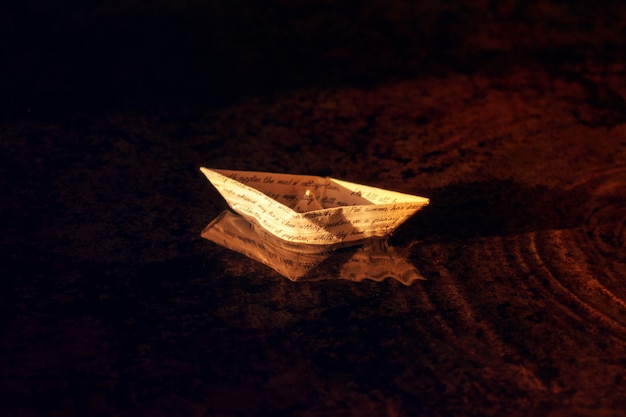 A paper boat from vintage letter with handwritten text