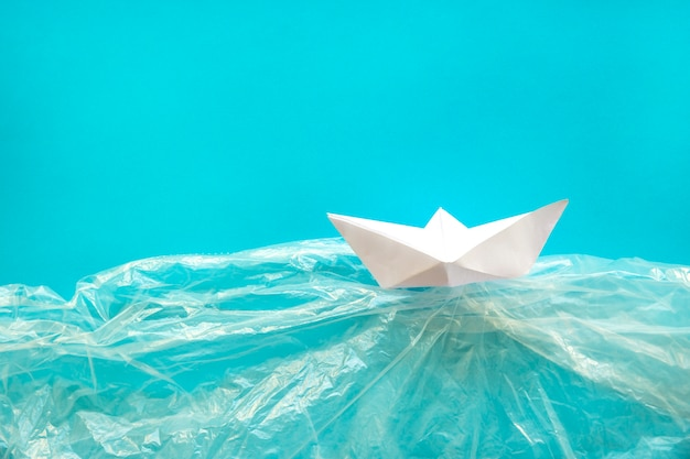 Paper boat in plastic water