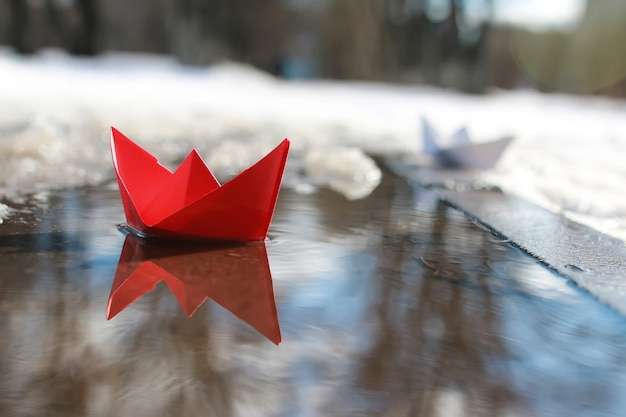 Paper boat in a pool