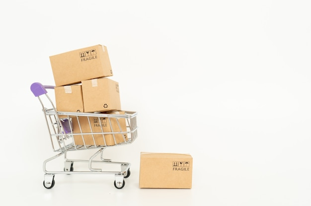 Paper boxes in a trolley on white background .online shopping or ecommmerce concept and delivery service concept with copy space