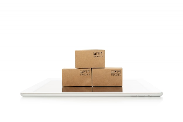 Paper boxes with tablet on white background,online shopping or ecommmerce concept