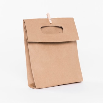 Paper carrier bag with handles for shopping and wooden clip