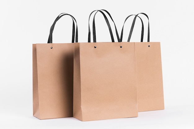 Paper carrier bags for shopping with black handles