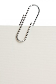 Paper clip on a piece of paper. close-up.