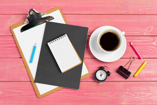 Paper on clipboard mock-up. modern woman workplace