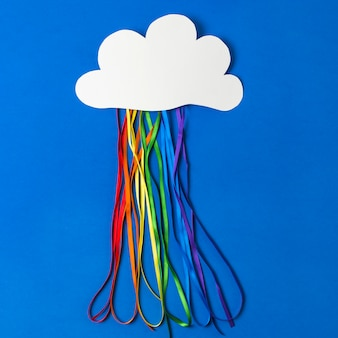 Paper cloud with colorful tinsels in lgbt colors