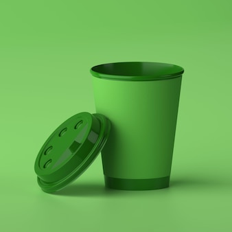 Бумажная кофейная чашка 3d дизайн макет зеленая чашка на зеленом фоне