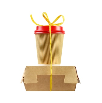 Paper coffee cup and food box tied with yellow rope isolated on white.