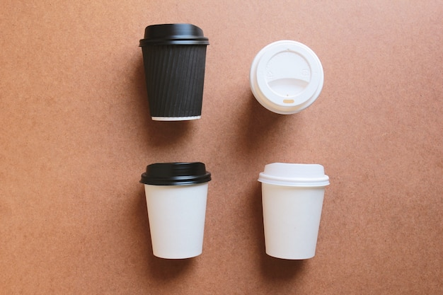 Paper coffee cups take away mock up on wood for business branding identity