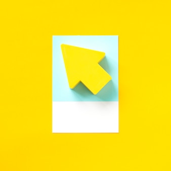 Paper craft art of a yellow arrow