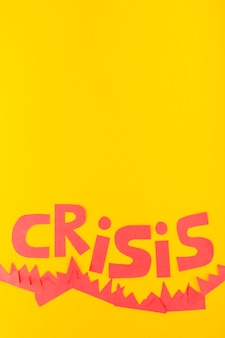 Paper crisis lettering on yellow background