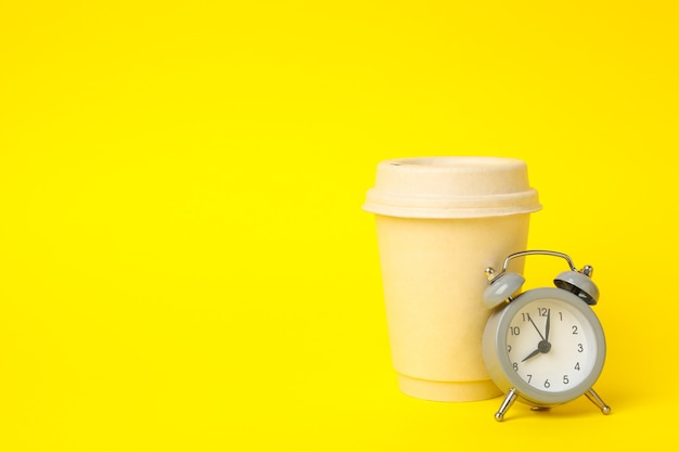 Paper cup and alarm clock o