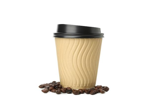 白で隔離の紙コップとコーヒーの種