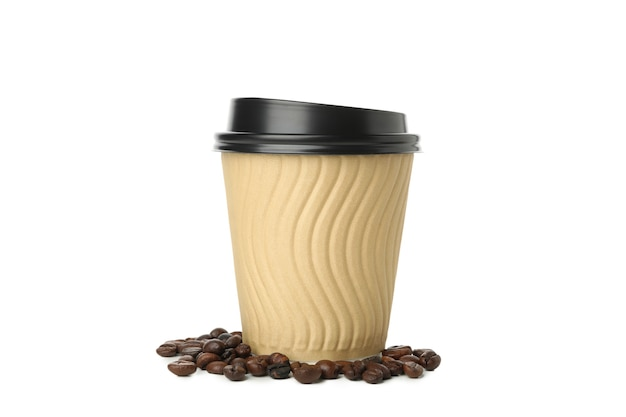 Paper cup and coffee seeds isolated on white