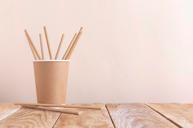 Paper cup holding paper straws