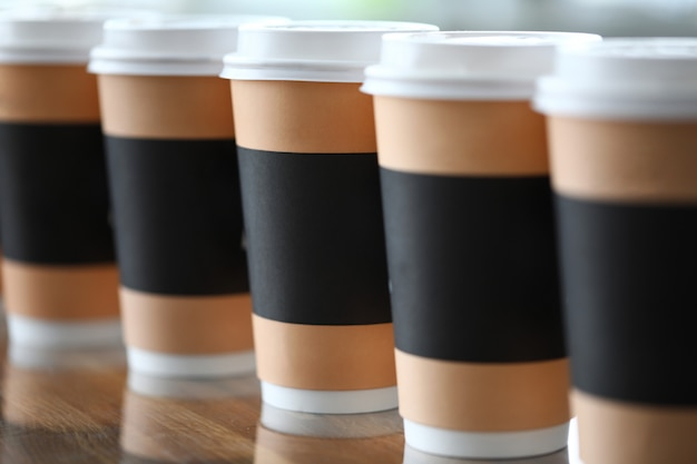 Paper cup line standing at table ready to be taken away