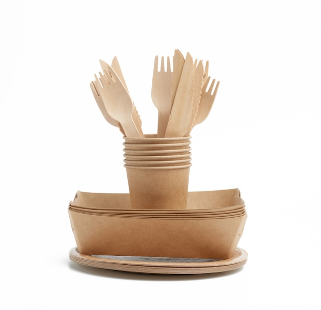 Paper cup,  plates from brown craft paper and wooden forks and knives