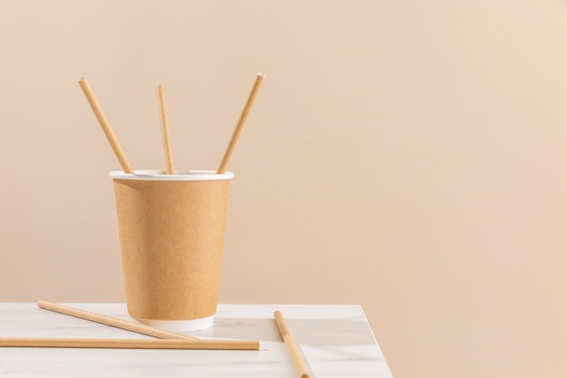 Paper cup and straws arrangement