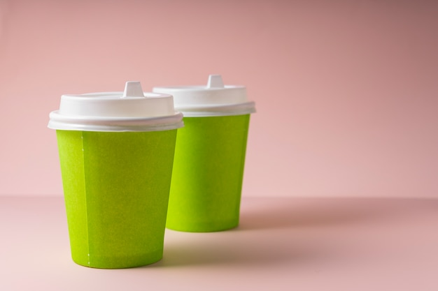 Paper cups for hot drinks coffee and tea, with a plastic lid, to take away.