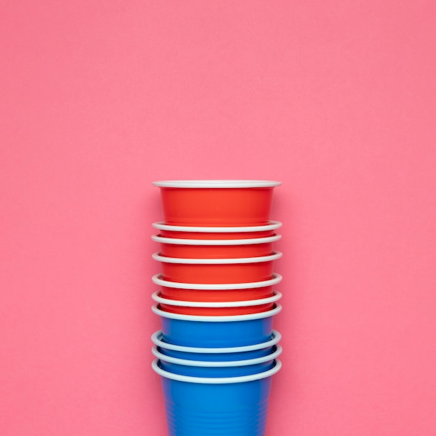 Paper cups on pink background