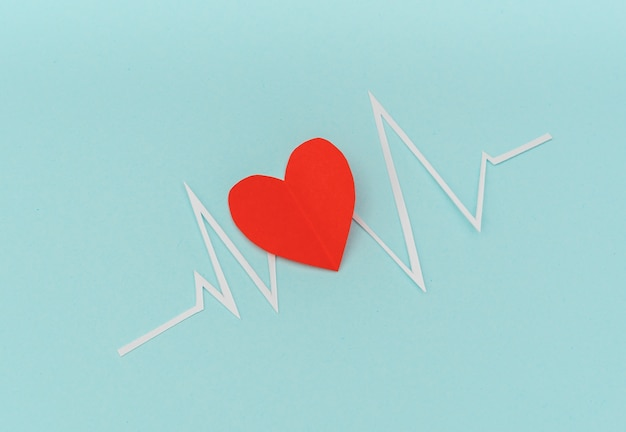 Paper cut of cardiogram of heart rhythm for valentines day .