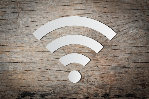 Paper cut of free wifi icon on wooden background