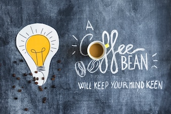 Paper cutout light bulb and coffee cup with message on chalkboard