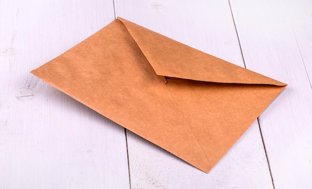 Paper envelope on a white wooden table.