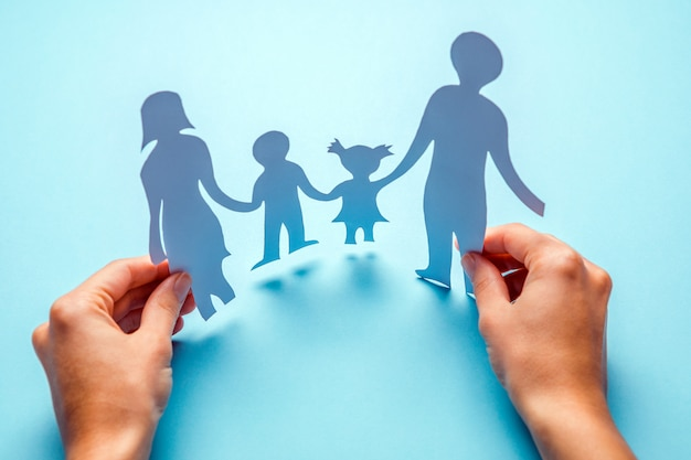 Paper family in hand isolated