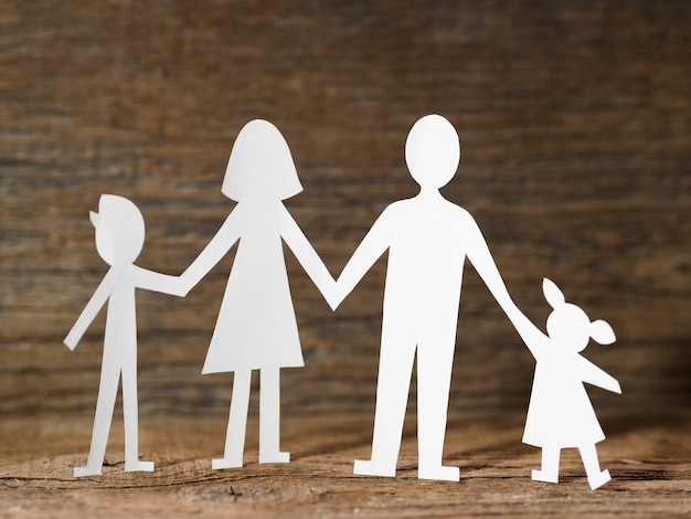 Paper family on wooden background