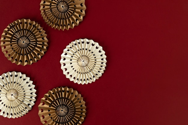 Paper fans over red background, chinese new year