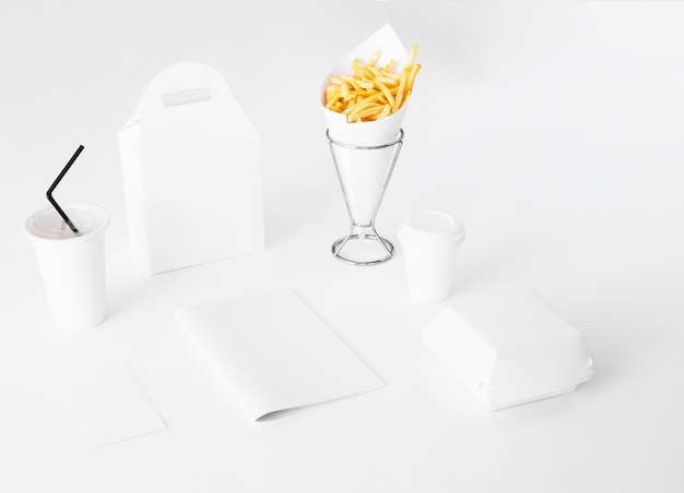 Paper fast food packaging on white background
