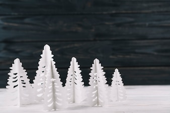 Paper fir trees on table