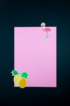 Paper flamingo and pineapples on blank pink card or note. minimal concept.