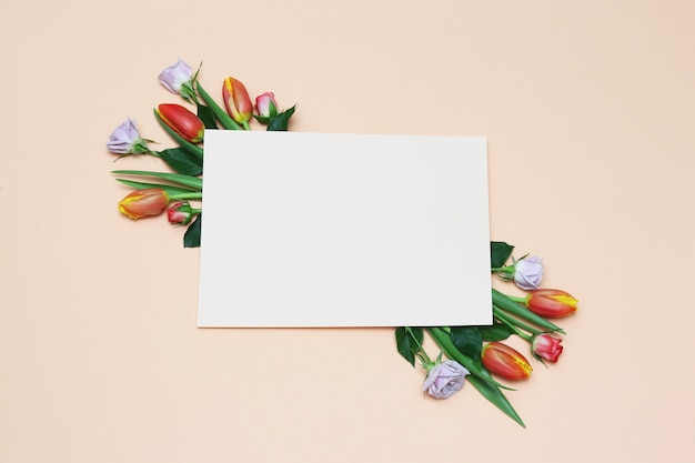 Paper frame with red tulips, white roses, green leaves