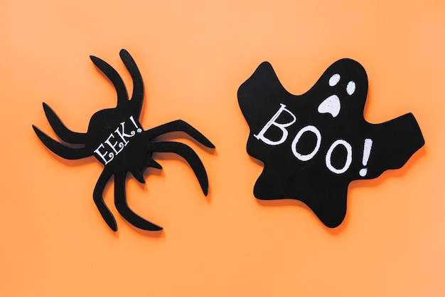 Paper ghost and spider with boo! and eek! inscriptions