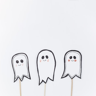 Paper ghosts on sticks for halloween