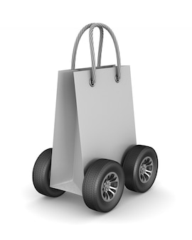Paper gift bag with wheels on white.